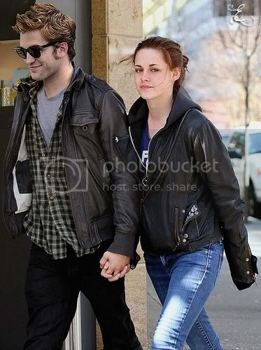 Robert Pattinson and Kristen Stewart holding hands. Pictures, Images and Photos